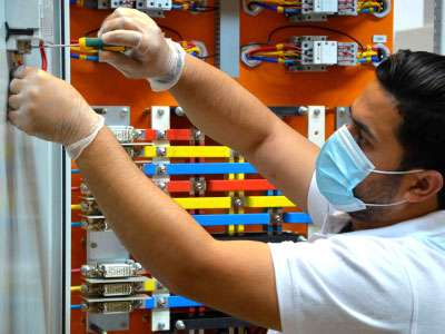 capacitor bank being assembled by engineer